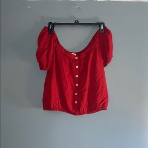 Cropped red button off the shoulder shirt